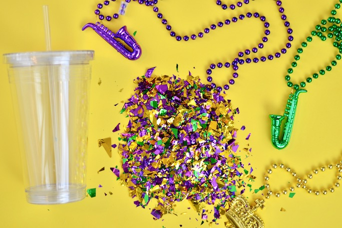 The cutest Mardi Gras DIY Confetti Go Cup! Add glitter or confetti to your tumbler for the perfect go-cup to carry around in New Orleans!