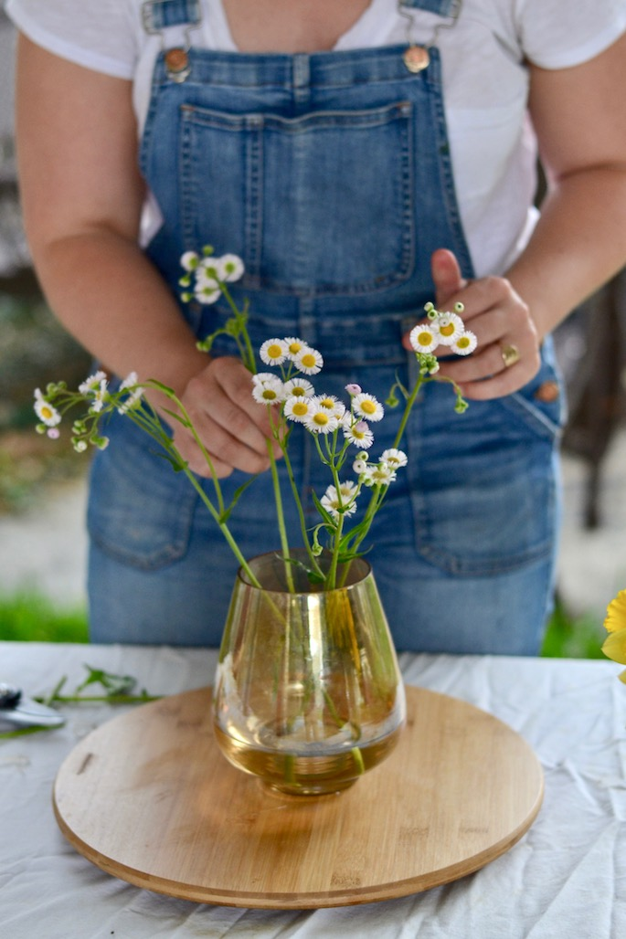 Mary Johnston of Merry Floral, based out of Baton Rouge, Louisiana, makes a table flower arrangement. Read about her business and her tips on Southern Flair!