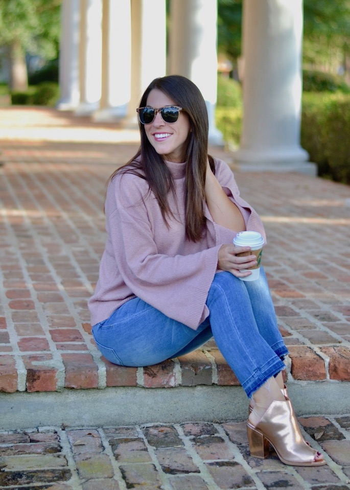 How to style a blush pink bell sleeve sweater with denim